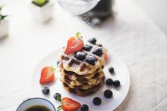 Waffles being sprinkled with sugar royalty free stock image