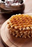 Waffles belgas na tabela de madeira Fotografia de Stock