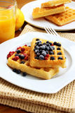 Waffles with berries. Waffles with blueberries placed over each other, sweet dessert royalty free stock photography