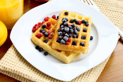 Waffles with berries. Waffles with blueberries placed over each other, sweet dessert stock images