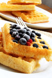 Waffles with berries. Waffles with blueberries placed over each other, sweet dessert royalty free stock photos