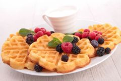 Waffles and berries Stock Images