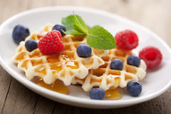 Waffles with berries and honey Royalty Free Stock Photography