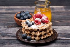 Waffles with berries and honey. Stock Photo