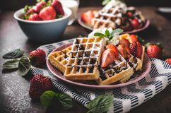Waffles with berries, strawberries stock photography