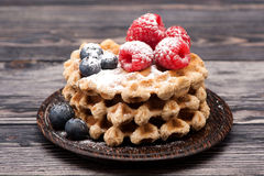 Waffles with berries. Sweet waffles with fresh berries for a healthy breakfast stock photography