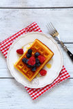 Waffles with berries top view Royalty Free Stock Images
