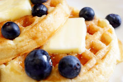 Waffles and blueberries macro Stock Images