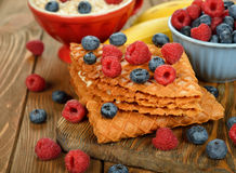 Waffles with blueberries and raspberries Stock Image