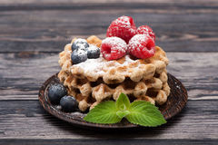 Waffles with blueberries and raspberries. Royalty Free Stock Image