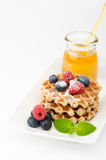 Waffles with blueberries, raspberries and honey. Healthy Breakfast Stock Image