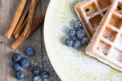 Waffles. With blueberries on a rustic table royalty free stock images