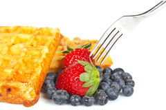 Waffles, blueberries and strawberries Stock Photography