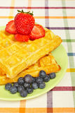 Waffles, blueberries and strawberries Royalty Free Stock Image
