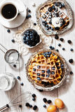 Waffles and blueberries Stock Images