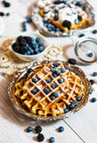 Waffles and blueberries Royalty Free Stock Photos