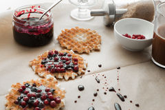 Waffles with blueberry jam and cowberry Stock Photo