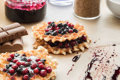 Waffles with blueberry jam and cowberry Stock Images