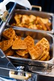 Waffles at a breakfast buffet Stock Images