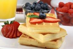 Waffles breakfast with orange juice Royalty Free Stock Image