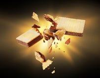 Waffles broken into pieces in the dark stock images