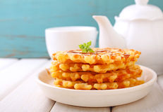 Waffles with caramel sauce. Weekend breakfast: waffles with caramel sauce stock images