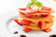 Waffles with caramel sauce, whipped cream and strawberries Royalty Free Stock Photo