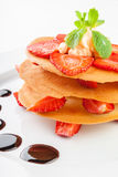 Waffles with caramel sauce, whipped cream and strawberries Royalty Free Stock Image
