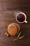 Waffles with caramel and tea on wood Stock Image