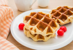 Waffles with cherries on plate Stock Photography