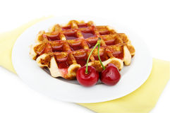 Waffles and cherry. Waffles with jam on white plate  with cherries Stock Photography