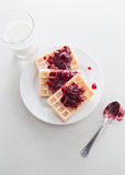 Waffles with cherry jam Stock Images