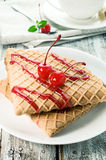 Waffles with cherry topping Royalty Free Stock Photos