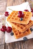 Waffles and cherry Royalty Free Stock Image