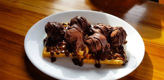 Waffles with chocolate and chocolate ice cream, El Chalten, Argentina royalty free stock images