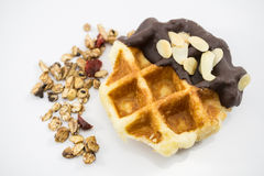 Waffles with chocolate, nut and granola white background. Stock Photos