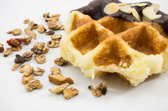 Waffles with chocolate, nut and granola white background. Royalty Free Stock Photo