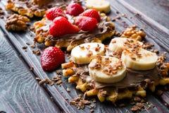 Waffles with chocolate paste, strawberries, bananas Stock Image