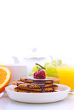 Waffles with chocolate and raspberries, grapes, tea and orange juice. Weekend breakfast: waffles with chocolate and raspberries, grapes, tea and orange juice royalty free stock photography