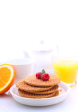 Waffles with chocolate and raspberries, grapes, tea and orange juice. Weekend breakfast: waffles with chocolate and raspberry, tea and orange juice stock photography
