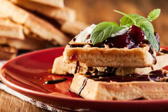 Waffles with chocolate sauce, whipped cream and confiture Royalty Free Stock Images