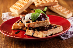 Waffles with chocolate sauce, whipped cream and confiture Stock Image