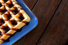 Waffles with chocolate sauce on wooden table background. Have some space for write wording stock photos