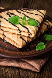 Waffles with chocolate topping and mint Royalty Free Stock Photo