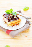 Waffles with chocolate on a white plate Royalty Free Stock Photo