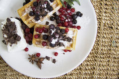 Waffles with cinnamon and berries Royalty Free Stock Photo
