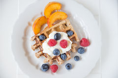 Waffles with clotted cream and berries Stock Photos