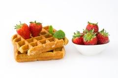 Waffles com as morangos no fundo branco Fotos de Stock
