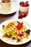 Waffles com mel e bagas Imagens de Stock Royalty Free