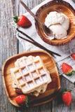 Waffles com morangos e gelado Fotografia de Stock Royalty Free